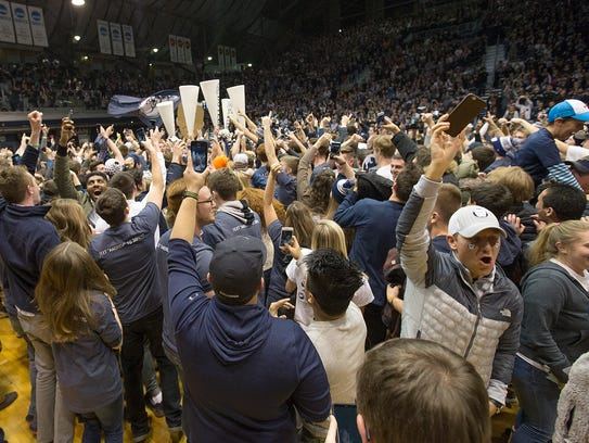 The Butler Bulldogs fans storm the court following