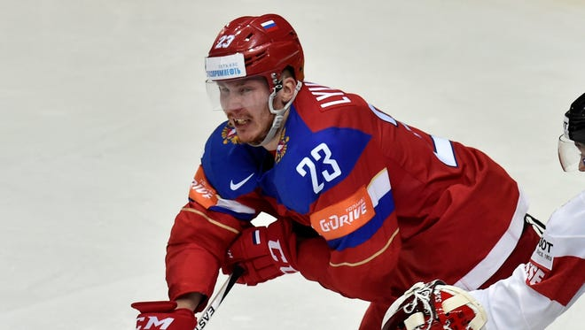 Roman Lyubimov, left, played a big role for Russia in the World Championships before signing with the Flyers.