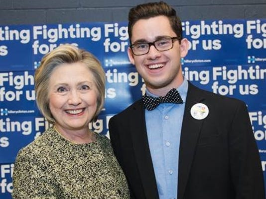 Clark Collier stands with Clinton
