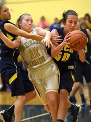 Elco's Ryelle Shuey, right, was the county's top freshman girls basketball player this season.