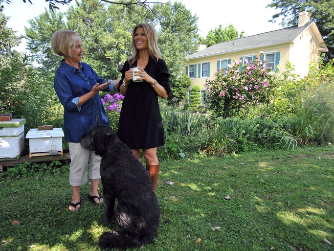 Leslie Rector, left,  and her daughter Max Paz stand in front of the Rector's home in Richland Township. Rector and Paz have been creating their own line of skin-care products, salves and teas for several years named Lulu and Max.