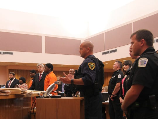 Greenville County Sheriff's Office Deputy Brandon Surratt, center, gives a statement during a sentencing hearing Tuesday in the case involving the death of police dog Hyco. Surratt was an Anderson County Sheriff's Office deputy and Hyco's handler when the dog was shot on Oct. 21, 2015..