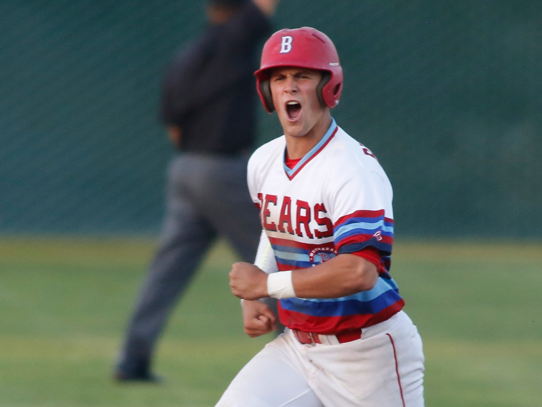 Buchanan's Ross Dodds celebrates a two-run home run during Wednesday's semifinal win over Tulare Western.
