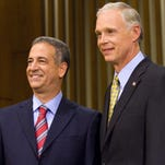 Russ Feingold, left, and Ron Johnson pose for a photograph before they take part in the U.S. Senate campaign debate at Marquette University Law School in Milwaukee in October 2010.