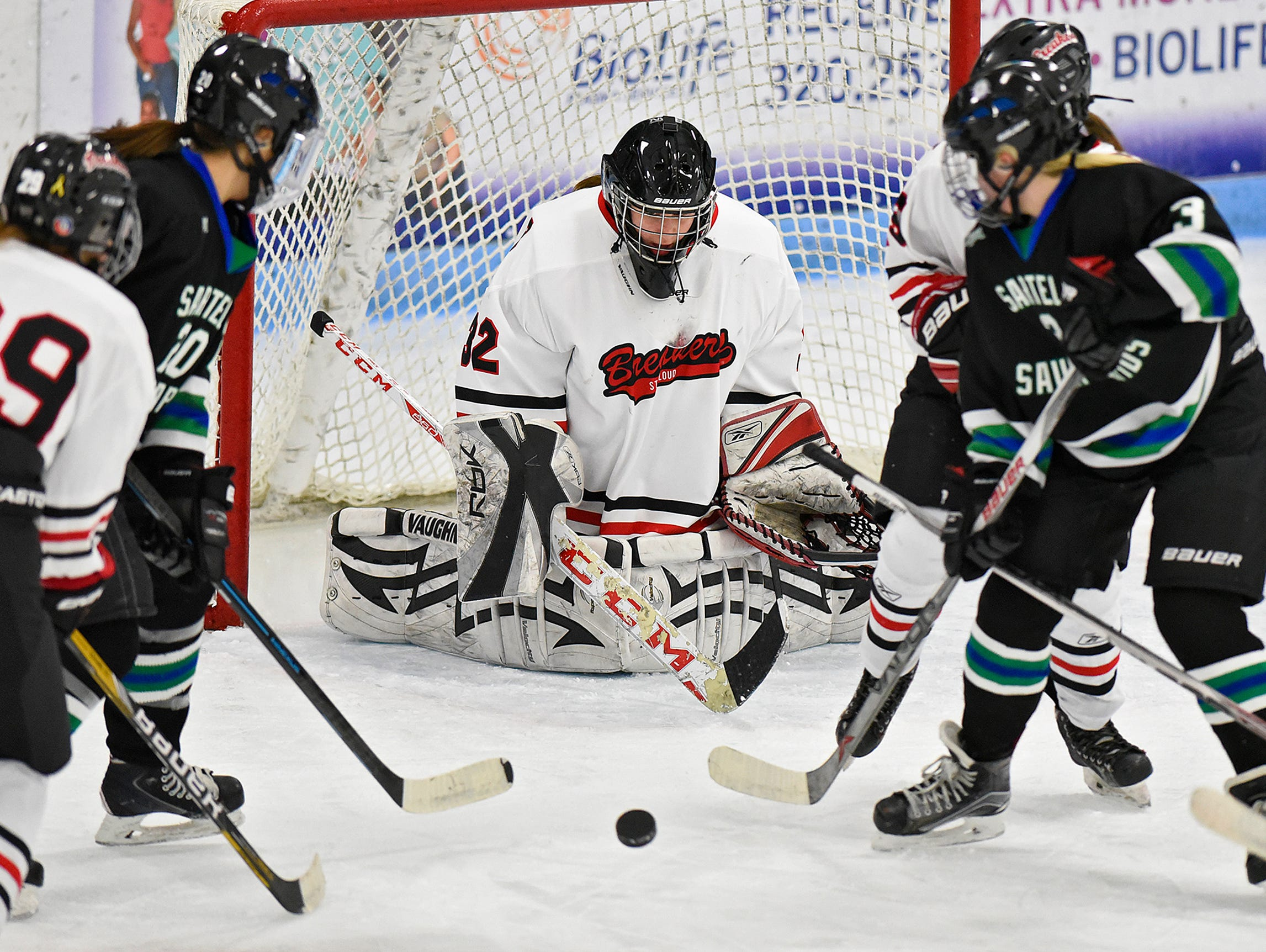 The puck bounces past Icebreakers goaltender Emily Musielewicz during the first period of Thursday's game at the MAC in St. Cloud.
