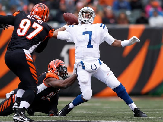 Indianapolis Colts quarterback Jacoby Brissett (7) is pressured by Cincinnati Bengals defensive end Chris Smith (94) at Paul Brown Stadium in Cincinnati on Sunday, Oct. 29, 2017.