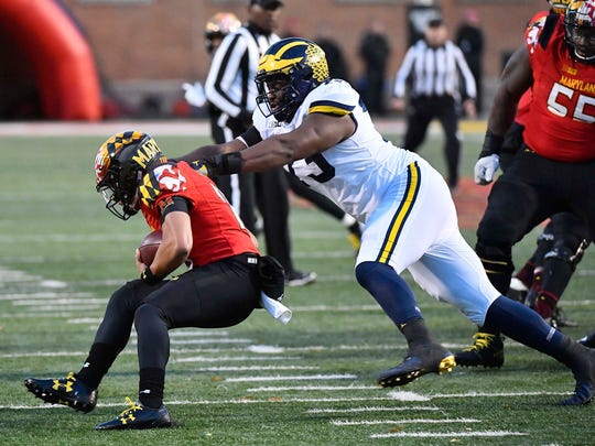 Michigan's Maurice Hurst tackles Maryland quarterback Ryan Brand for a loss in the first half Nov. 11.