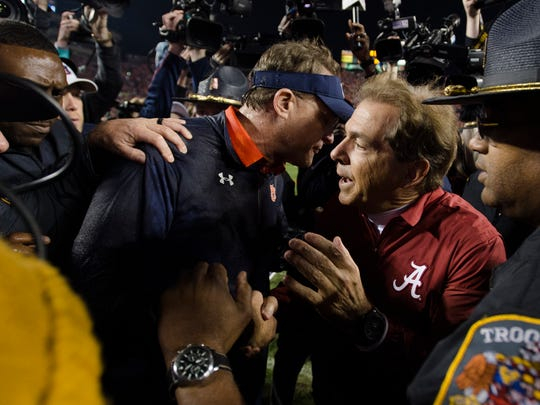 Auburn head coach Gus Malzahn greets Alabama head coach