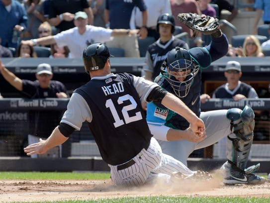 New York Yankees' Chase Headley (12) scores on a three-RBI