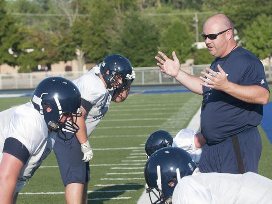 Marysville Coach Mark Caza speaks to his players Wednesday, Aug. 10 at Marysville High School.