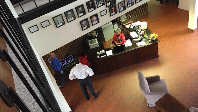 Matt Bevin talks to a receptionist at Kentucky Democratic Party headquarters.