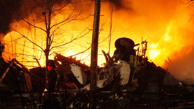 This Feb. 12, 2009, file photo shows Continental Airlines Flight 3407 operated by Manassas, Va.-based Colgan Air burning after it crashed into a house in Clarence Center, N.Y.