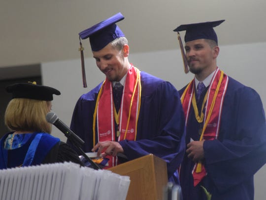 Twins Austin and Dustin Adams, both LSUA men's basketball players, were among LSUA students graduating Thursday. They received honors medals from Barbara Hatfield, provost and vice chancellor of Academic and Student Affairs.