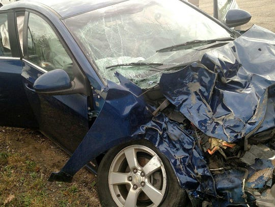 A school bus ran over the front of the 2013 Chevy Cruze