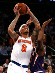 New York Knicks forward Michael Beasley (8) goes to