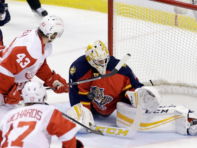 Panthers goalie Roberto Luongo (right) blocks a shot