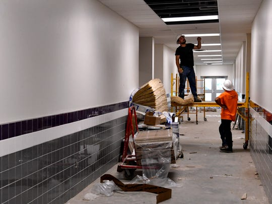 Men work in one of the hallways of Wylie East Elementary School. The new school is scheduled to be ready for the fall.
