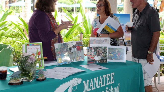 Mike and Sue Horowitz with Manatee Elementary representative.