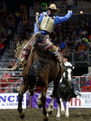 Doug Aldridge of Carthage, Mo., competes in the saddle bronc event at the Cinch World's Toughest Rodeo on Jan. 13, 2017, at Wells Fargo Arena.