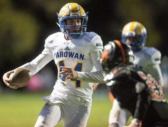 Parowan High School senior Porter Wood (44) runs the