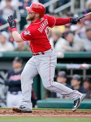 Cincinnati Reds catcher Tucker Barnhart (16) follows through on a two-run home run in the top of the third inning of the Spring Training opening game between the Cleveland Indians and the Cincinnati Reds at Goodyear Stadium in Goodyear, Ariz., on Friday, Feb. 23, 2018.