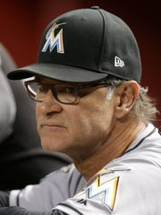 Miami Marlins manager Don Mattingly (8) in the first inning during a baseball game against the Arizona Diamondbacks, Saturday, June 2, 2018, in Phoenix. (AP Photo/Rick Scuteri)