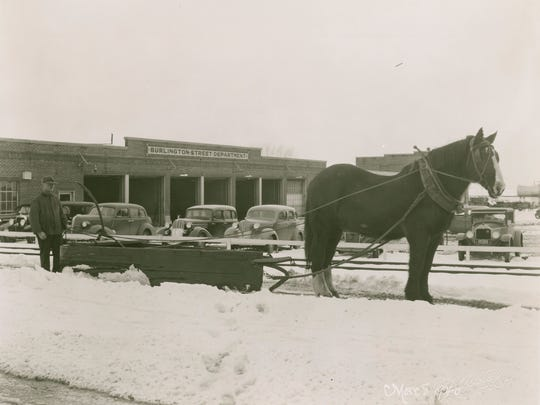Danny Bombard and one of the last horse-drawn sidewalk plows in Burlington, photographed in 1940.