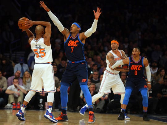 Oklahoma City Thunder power forward Carmelo Anthony (7) defends against New York Knicks point guard Jarrett Jack (55) during the first quarter at Madison Square Garden on Saturday, Dec. 16, 2017.