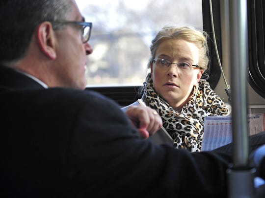 Stefanie Murray, right, talks with CEO Steve Bland on the MTA bus at Music City Central in downtown Nashville, Tenn., Friday, Jan. 30, 2015.