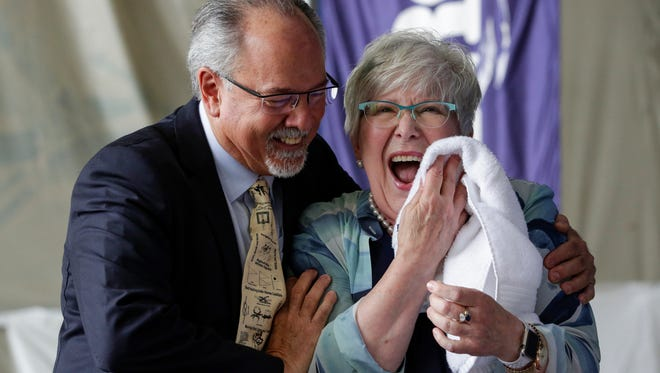 Burger Boat CEO Jim Ruffolo hugs Cyndy Stiehl as she wipes champagne from her face after christening her Burger 48 Cruiser yacht at the Burger shipyard Monday, June 18, 2018, in Manitowoc, Wis. Josh Clark/USA TODAY NETWORK-Wisconsin
