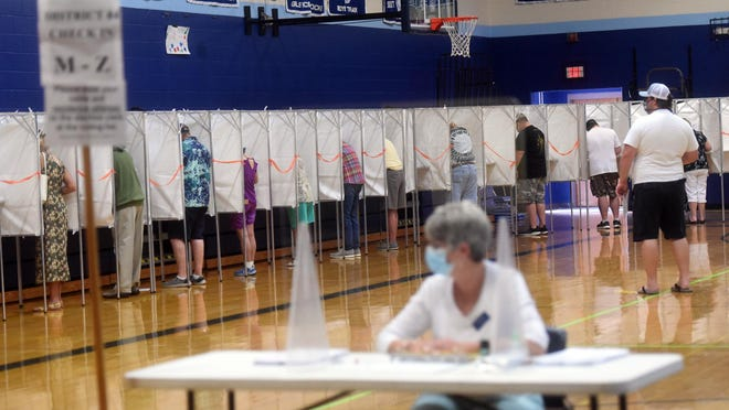 Voting booths were full as people social distanced and waited for their turn at the polls at York High School Tuesday.