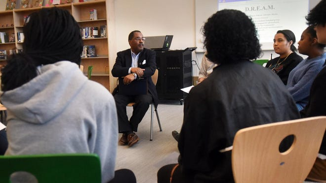 Rogers Johnson, president of the Seacoast NAACP,  speaks in February 2019 with students in the Dover High School group Project DREAM, which stands for diversity, respect, education, advocacy and mission. The student group has organized a candlelight vigil in memory of George Floyd to be held in Dover's Henry Law Park Monday, June 1, 2020, and Johnson will be a speaker.