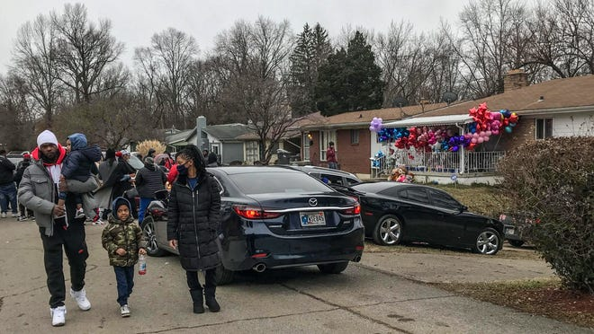 A vigil is held at the site of the an Indianapolis mass shooting in January where Kezzie Childs, 42, Raymond Childs, 42, Elijah Childs, 18, Rita Childs, 13, Kiara Hawkins, 19, and her unborn baby boy were killed. Mass shootings have increased during the pandemic, Gun Violence Archive data shows.