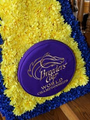 The actual Breeders Cup floral prize draped over American Pharoah when he won the Breeder's Cup Classic to close out his career in 2015. The real flowers have been replaced with fake ones. It is on display in the visitors center at Coolmore America in Versailles, Kentucky, where triple crown winner American Pharoah now lives.