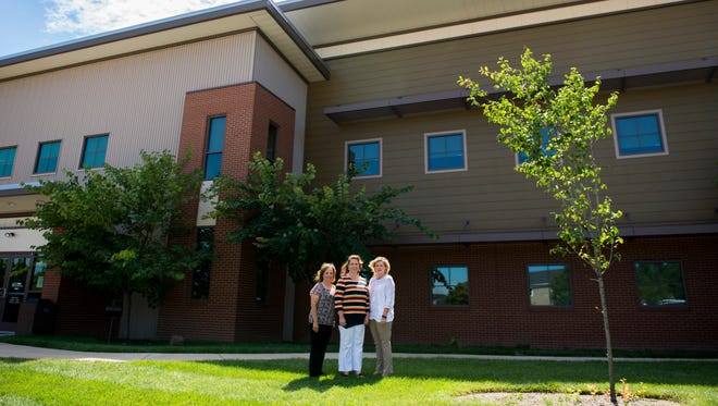 From left, Kim Rye, Montgomery County Career Services Director, Marla Rye, President, and Andrea Dillard, Vice President of Program Services, all pose for a portrait outside the Workforce Essentials building. The three have been with the company the longest, and are celebrating the company's 25-year anniversary.