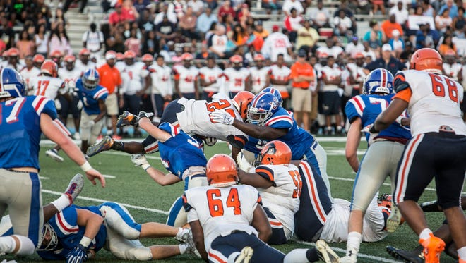 Ridgeway's Cameron Stansbury jumps for a first down during a game against Memphis University School on Aug.18, 2017.