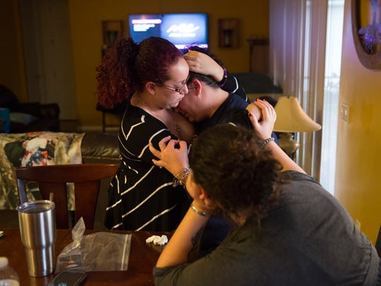 Sheara Ruiz, mother of fallen Marine Austin Ruiz, is comforted by close family friend Kathy Tur, left, and her daughter April Ruiz at her home Tuesday, Jan. 17, 2017 in Golden Gate Estates. Austin Ruiz was killed Friday, Jan. 13, 2017 during a Marine training exercise in Twentynine Palms, California.