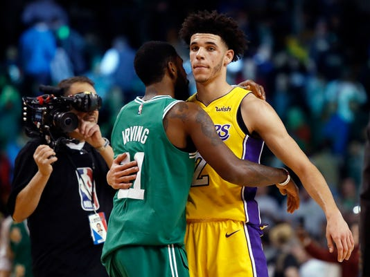 Boston Celtics guard Kyrie Irving embraces Los Angeles Lakers guard Lonzo Ball after Boston's 107-96 win in an NBA basketball game in Boston on Wednesday, Nov. 8, 2017. (AP Photo/Winslow Townson)