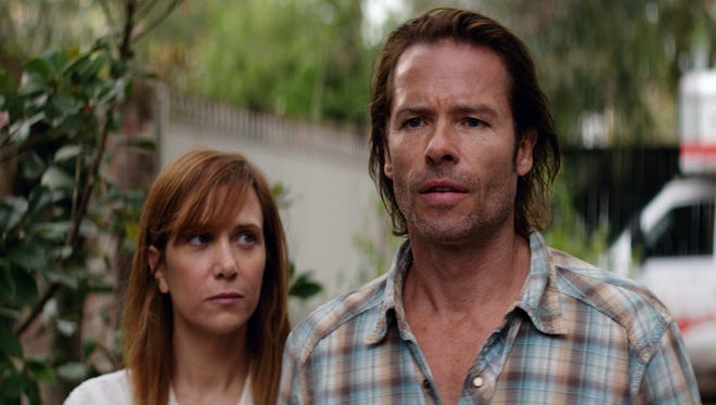 Kristin Wiig (left) and Guy Pearce in a scene from the film 'Hateship Loveship.'