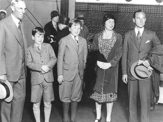 Henry Ford, left, greets Edsel Ford, far right, and his family after their trip to Europe on the SS Berengaria on June 21, 1929.