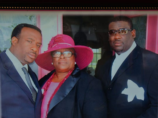 Alberta Wilson of Rockledge (seen here with her sons