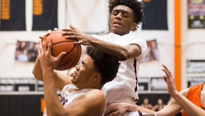 Bearden's Shamarcus Brown (35) and Trent Stephney (1) attempt to recover a rebound during a District 4AAA semifinals game between William Blount and Bearden at Lenoir City High School Saturday, Feb. 17, 2018.