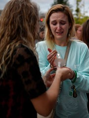 Crowd members light candles at Nashville's vigil for
