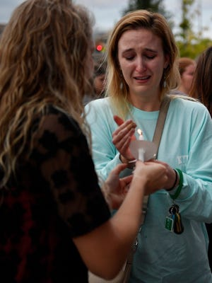 Crowd members light candles at Nashville's vigil for Las Vegas shooting victims Monday, Oct. 2, 2017, at Ascend Amphitheater in Nashville, Tenn.