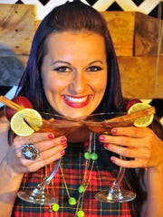 Jessica Haines, with the Sol-Tree Company, poses with crisp apple cider-tinis. The Melbourne Regional Chamber's Martinis & Mistletoe event will be from 6-9 p.m. Dec. 5 at Rosner Chevrolet.