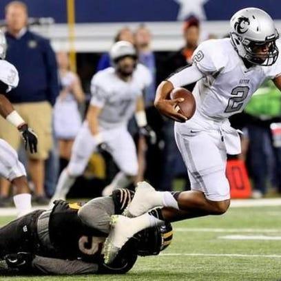 Denton Guyer quarterback Jerrod Heard is tripped up
