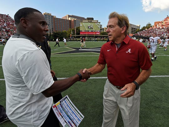 Alabama head coach Nick Saban shakes hands with Vanderbilt