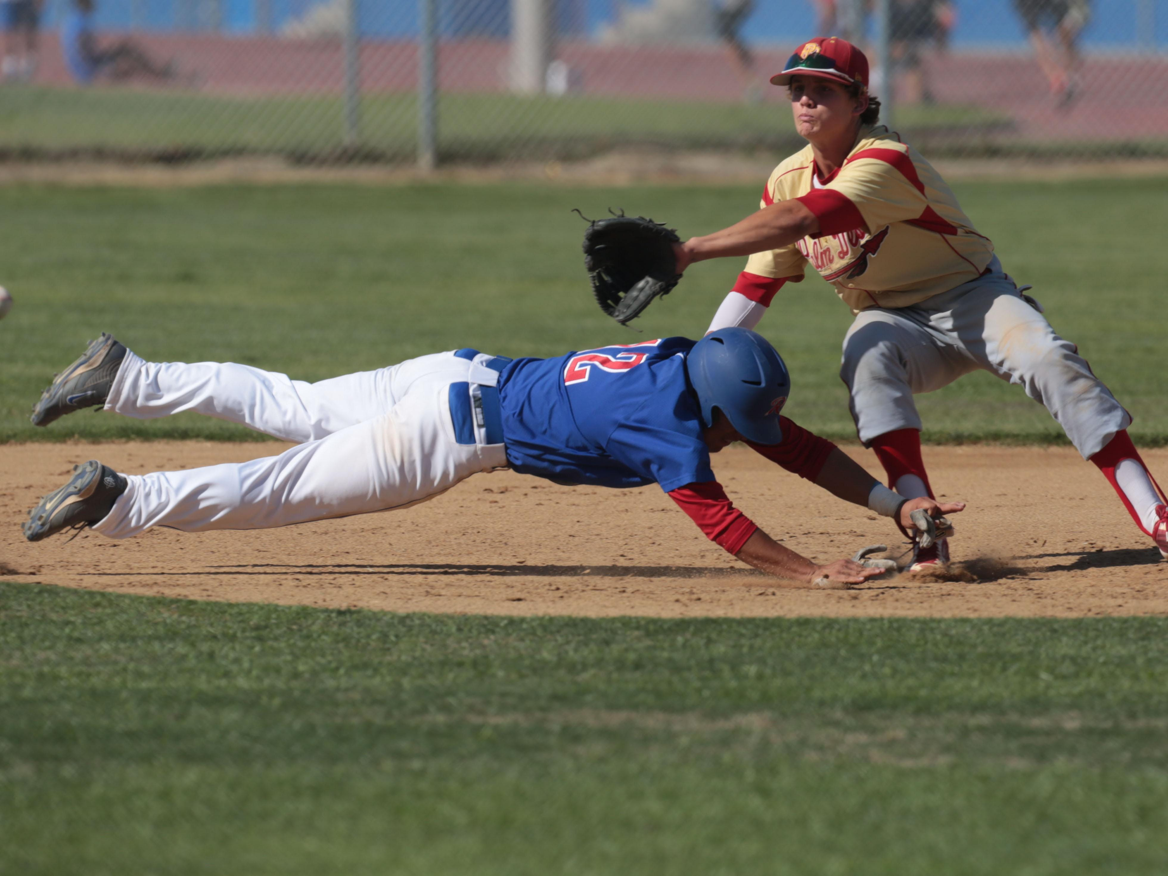 Indio's Jonathan Diaz dives safely back on to second as the ball reaches Palm Desert's Travis Moniot on Tuesday, April 15, 2014 in Indio.
