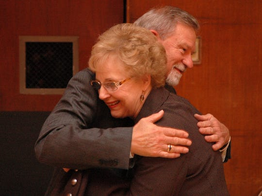 University staff member Linda Painter says goodbye to former Chancellor Loren Crabtree during a reception in his honor at the University of Tennessee after Crabtree announced that he was stepping down as chancellor.