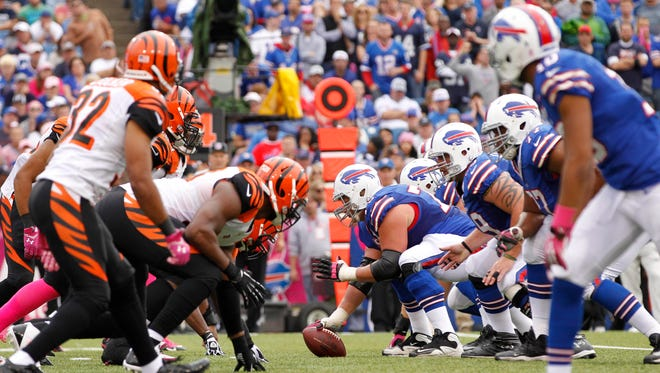 Oct 13, 2013; Orchard Park, NY, USA; Buffalo Bills offense lines up against the Cincinnati Bengals defense during the second half at Ralph Wilson Stadium. Bengals beat the Bills 27-24 in overtime.